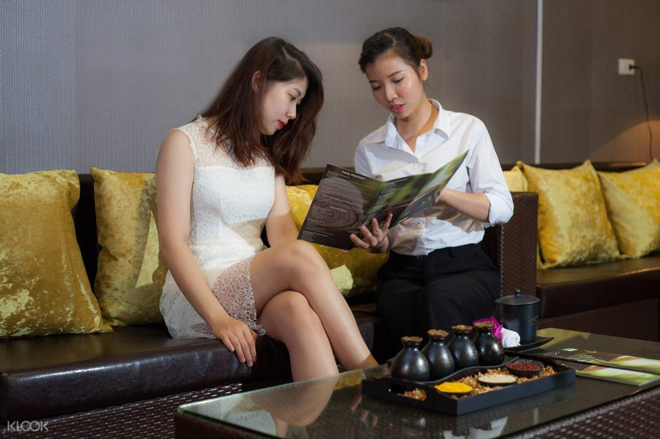 lady guest enjoying a foot massage
